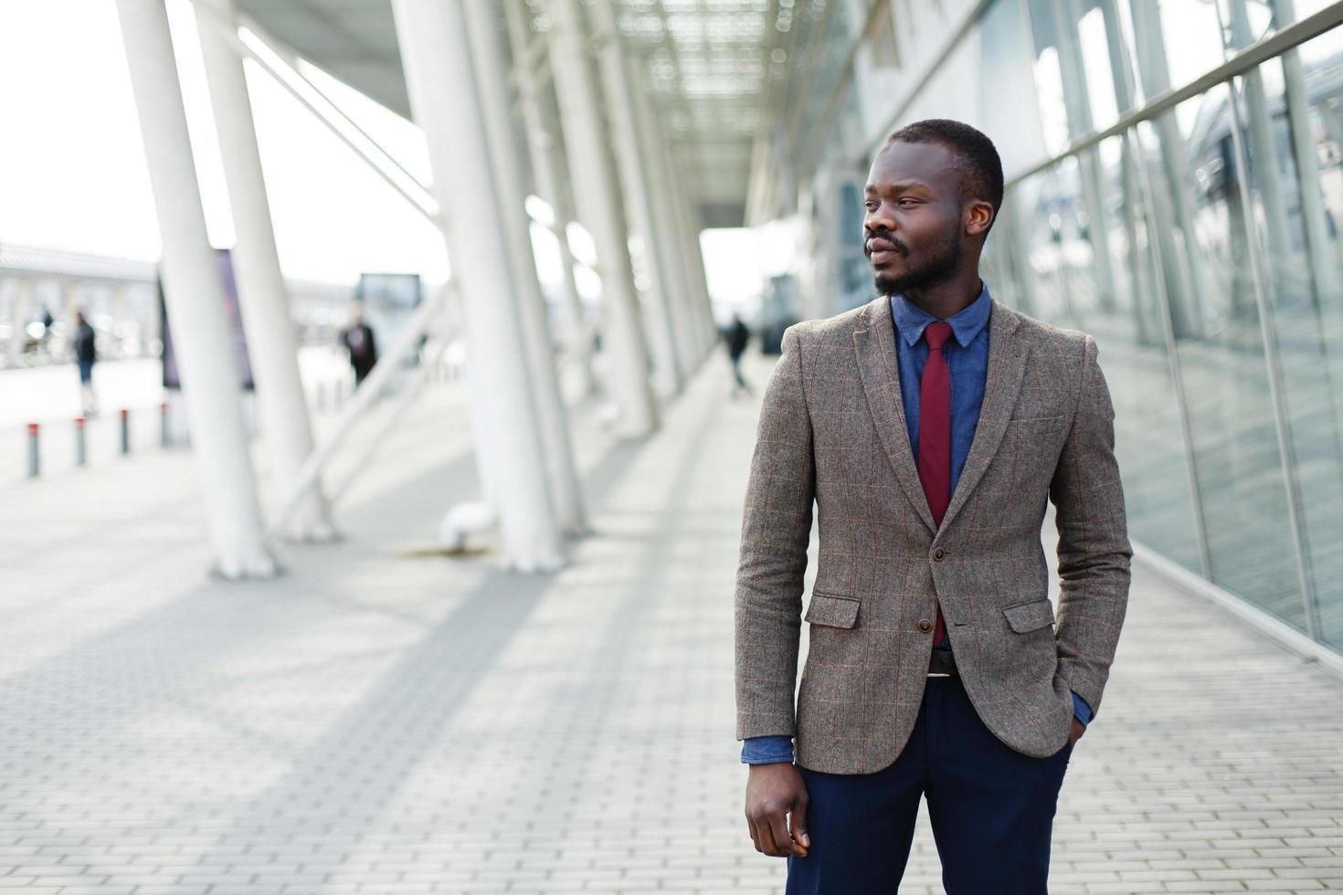 Stylish African American black businessman poses in a suit photo