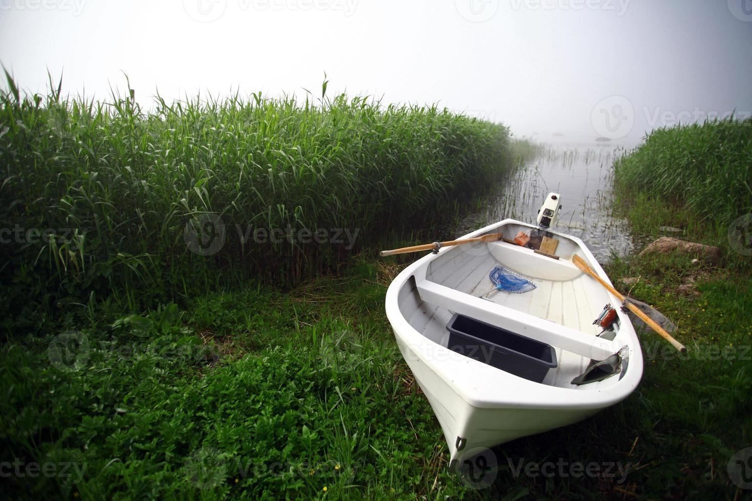 Boat on a foggy day photo