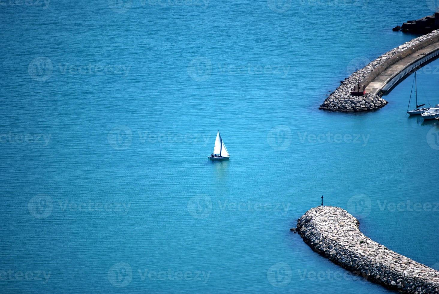 Sailing boat entering the port photo