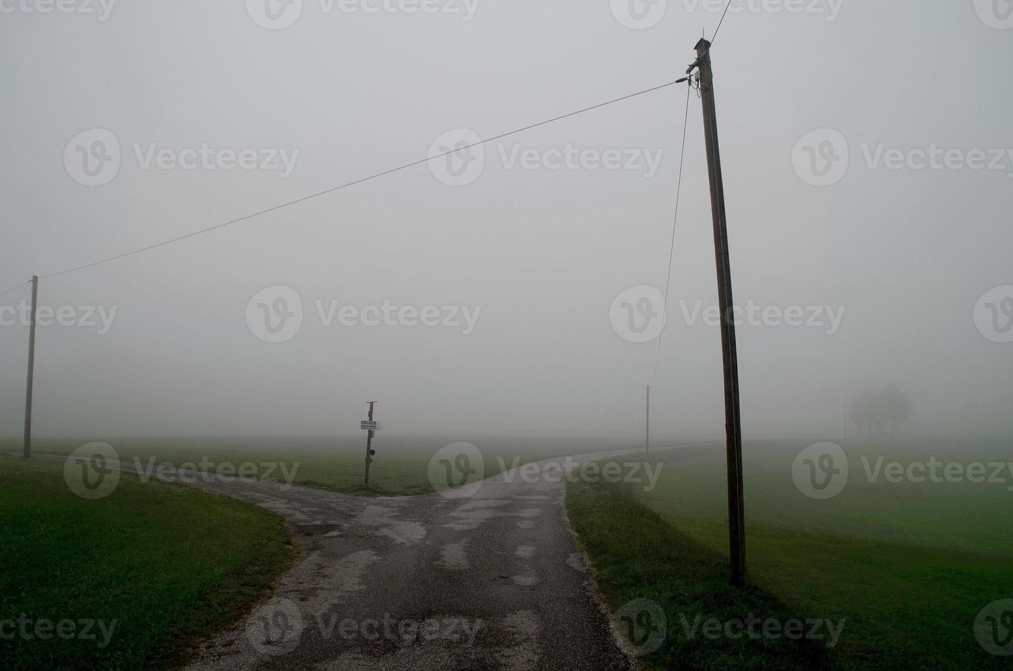 Crossroad in the fog. photo