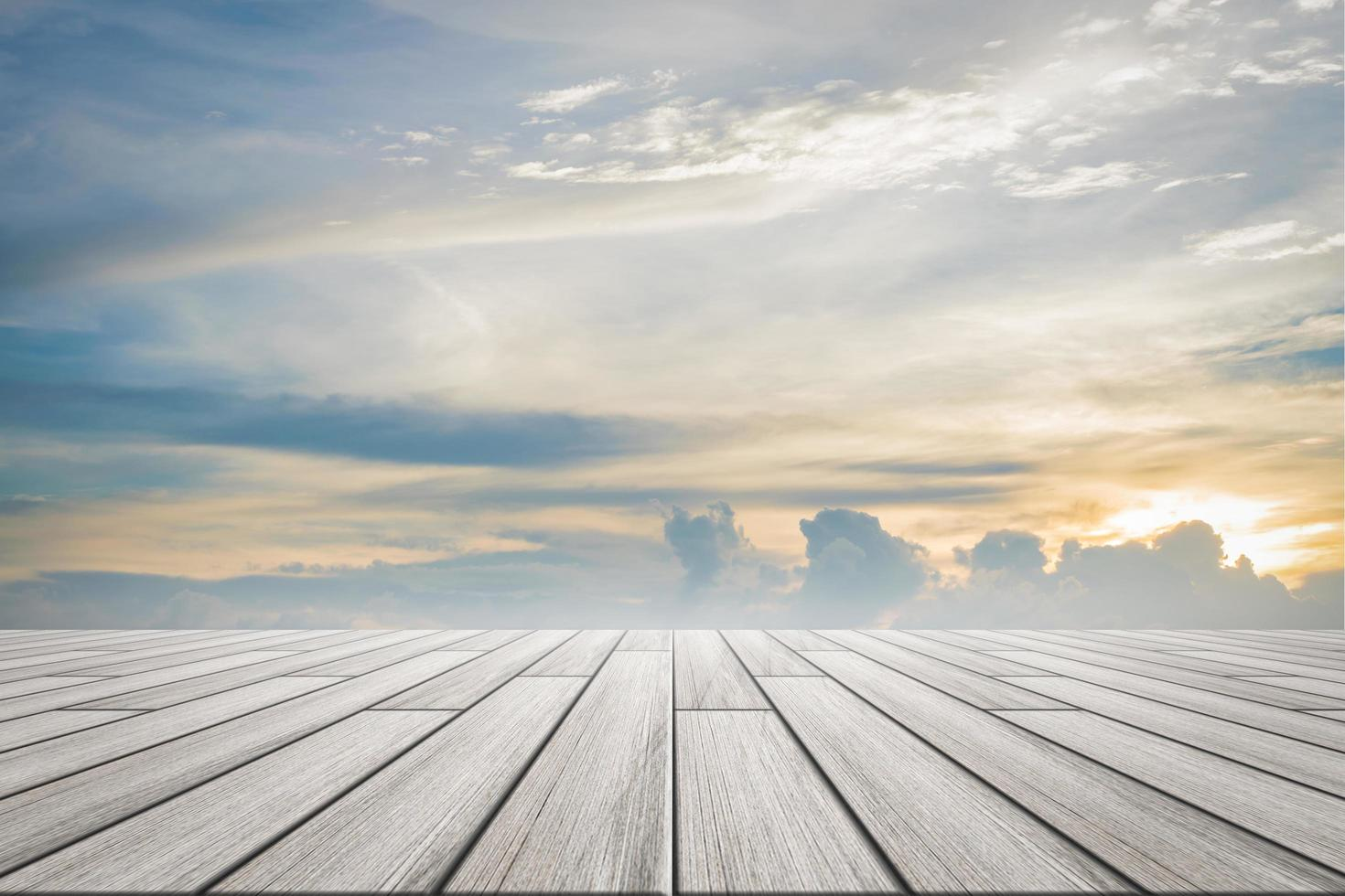 Wood floor plates with sunset sky background photo
