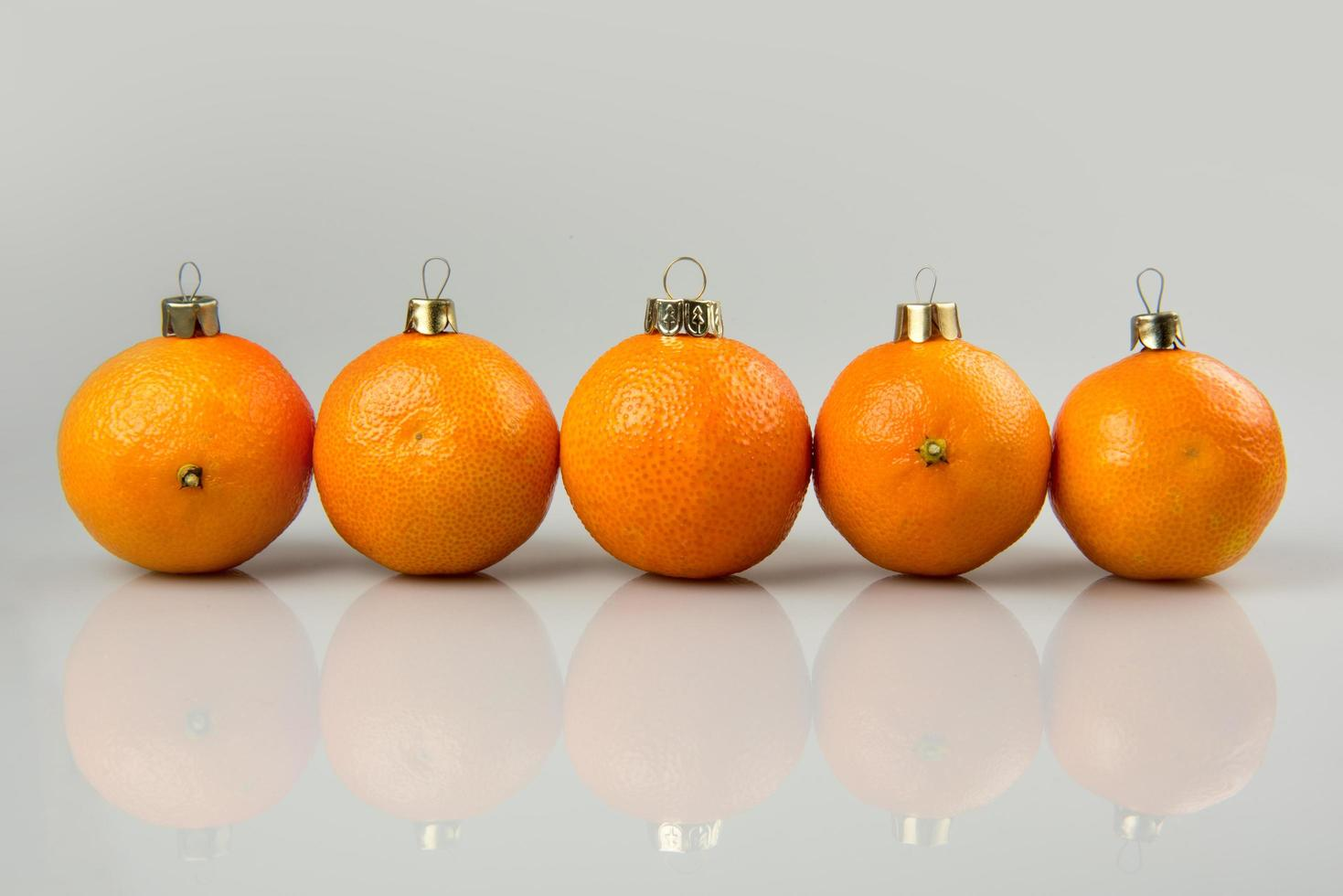 A line of tangerine baubles photo