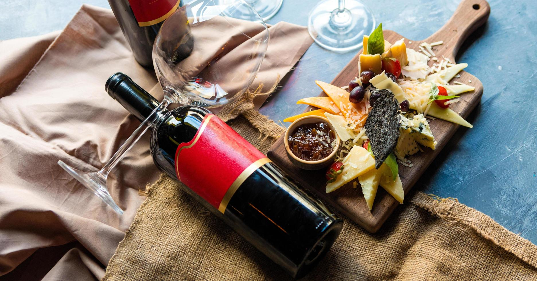 Charcuterie cheese board with wine photo