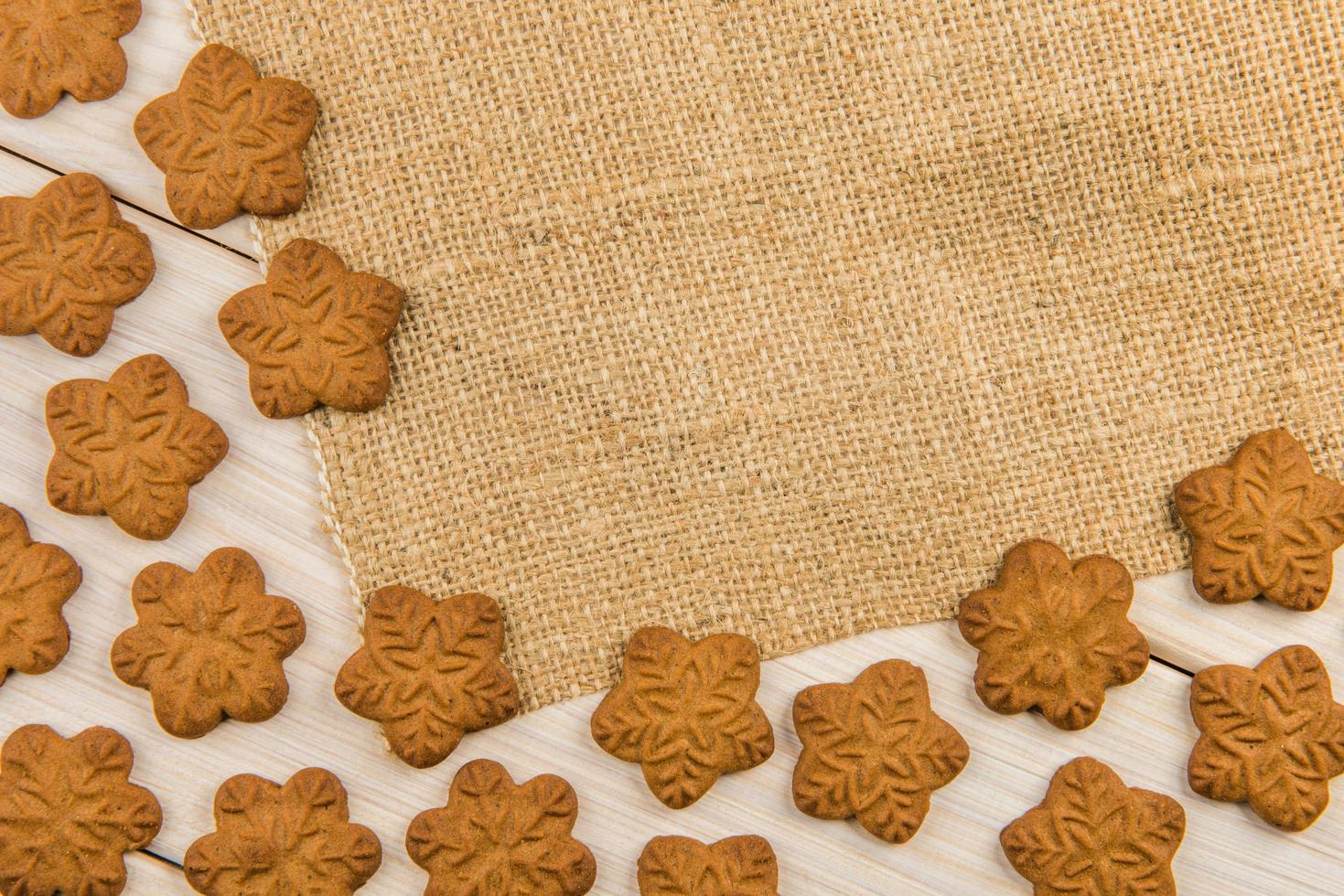 Snowflake gingerbread cookies with sackcloth photo
