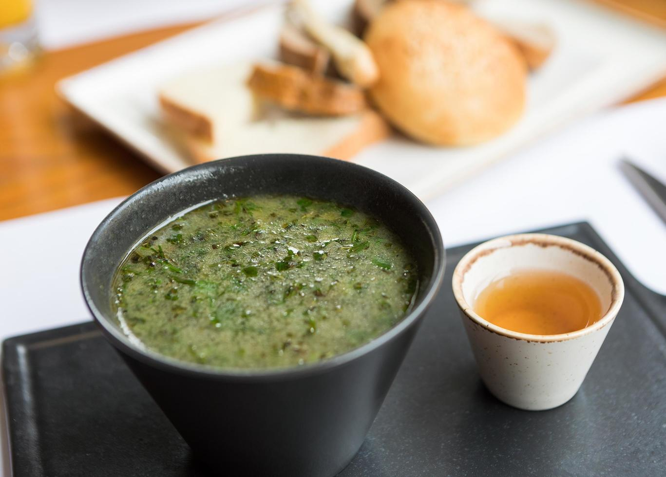 Green soup with sauce photo