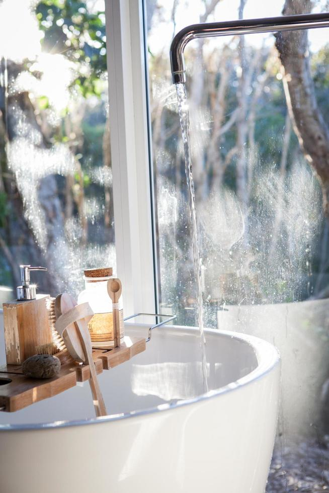 White ceramic sink near a window photo