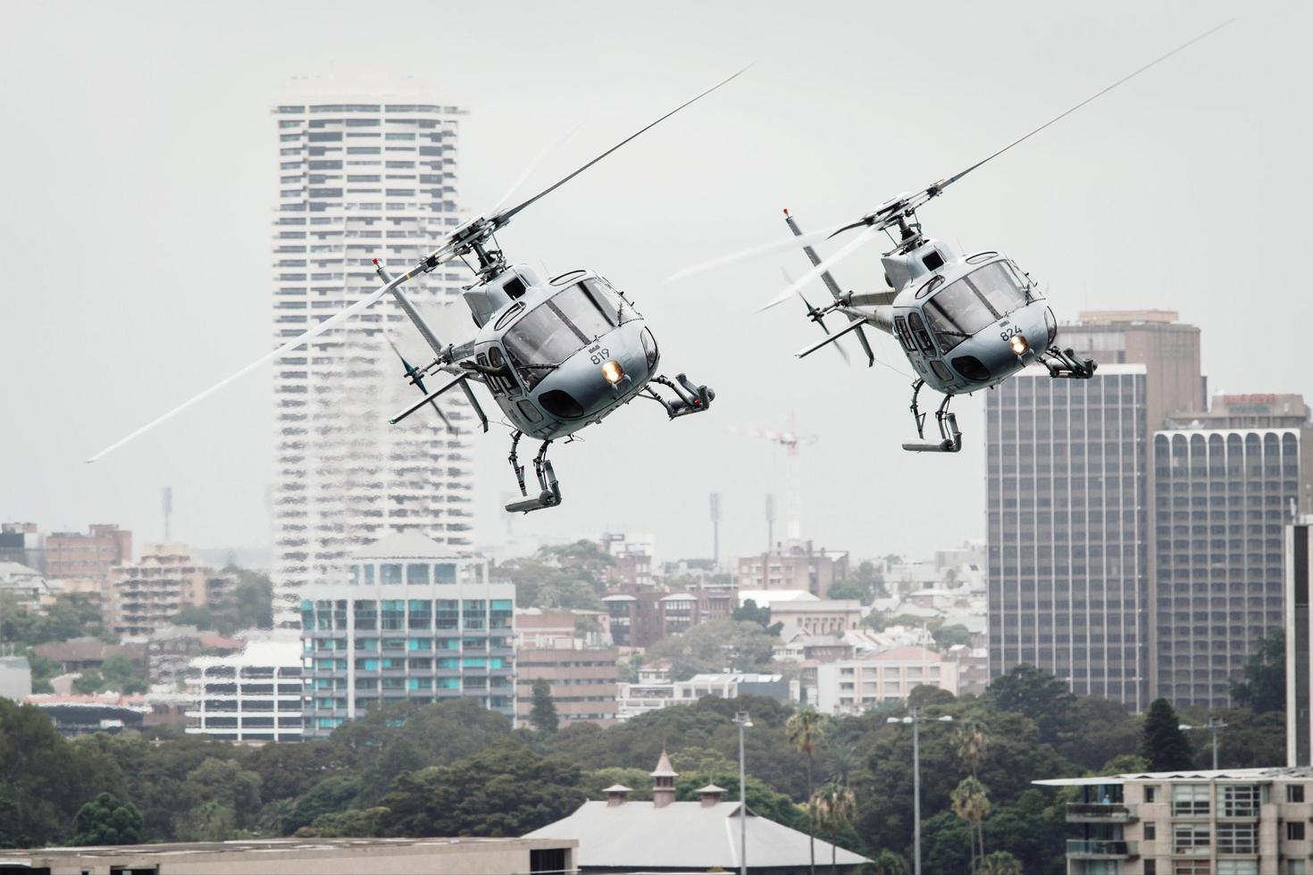 Sydney, Australia, 2020 - Two helicopters flying in the city photo
