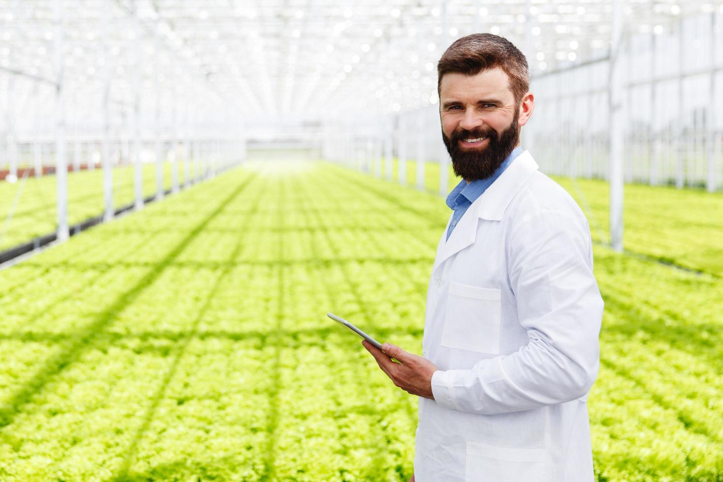 Male researcher in a green house photo