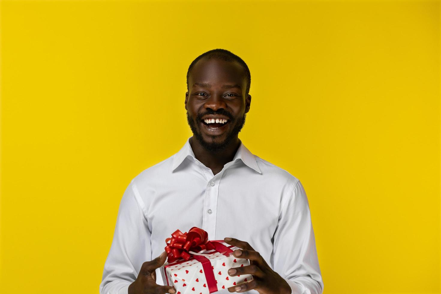Excited man holding a gift photo