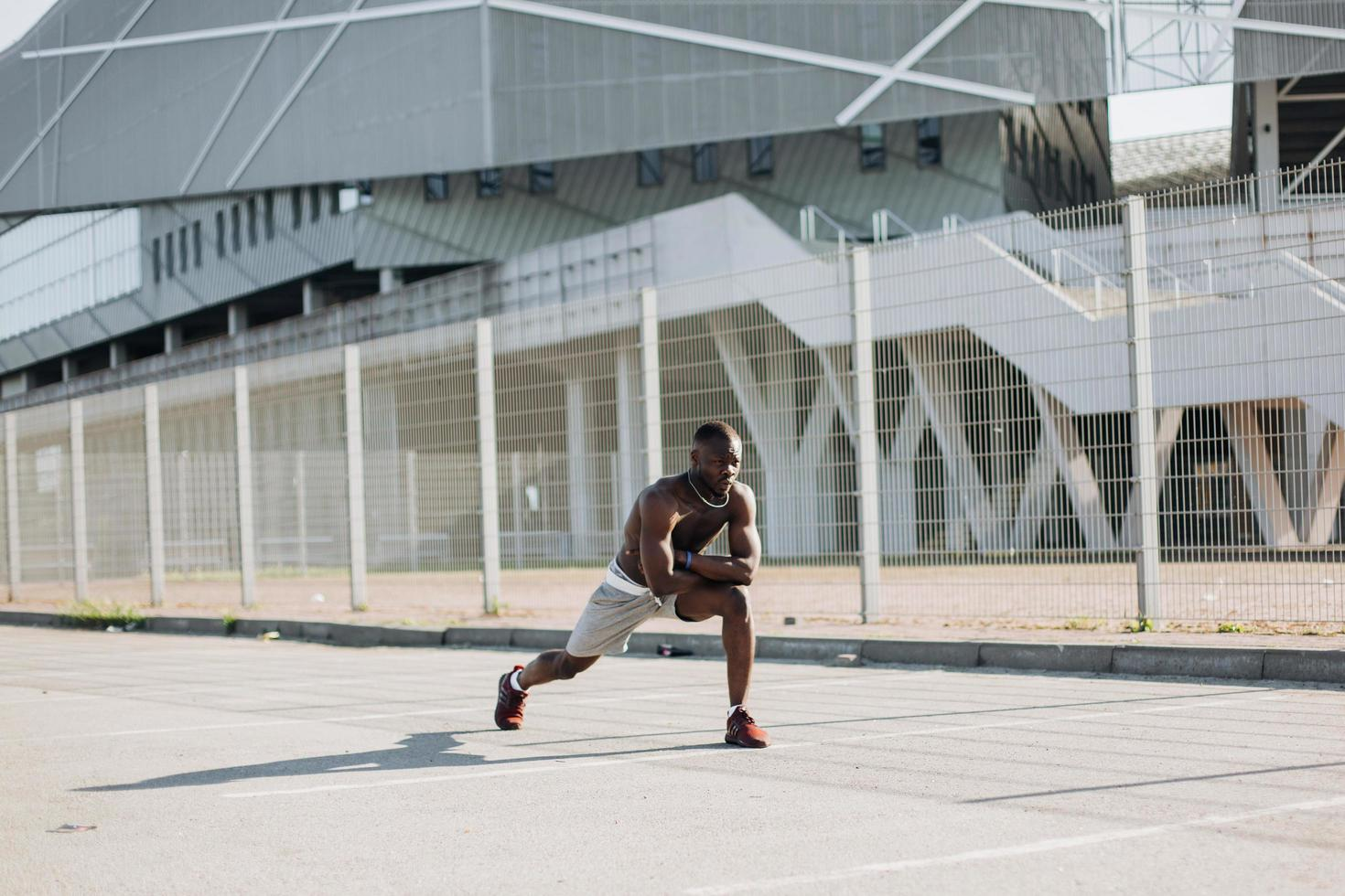 African American man doing lunges photo