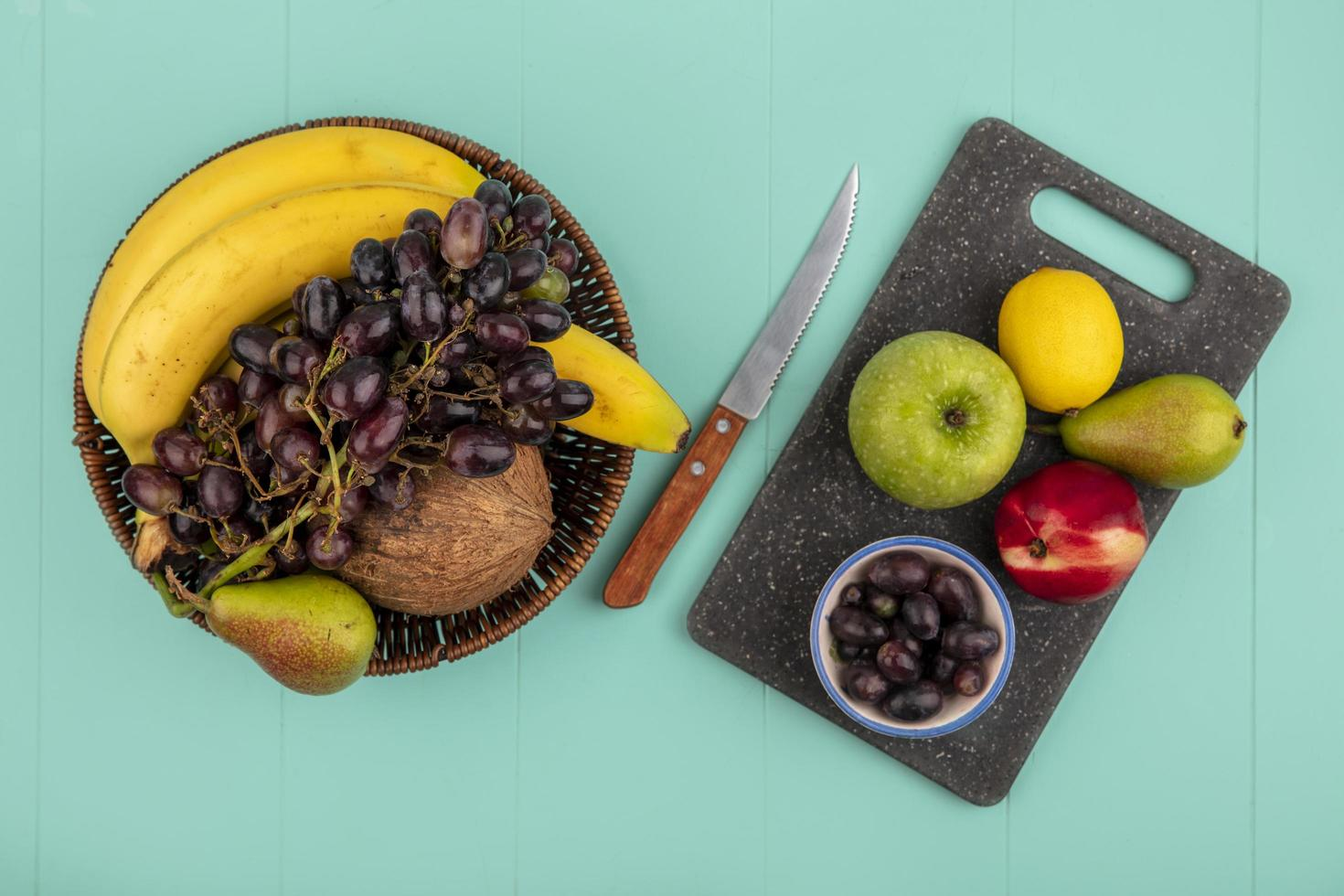 Assorted fruit on green background with copy space photo