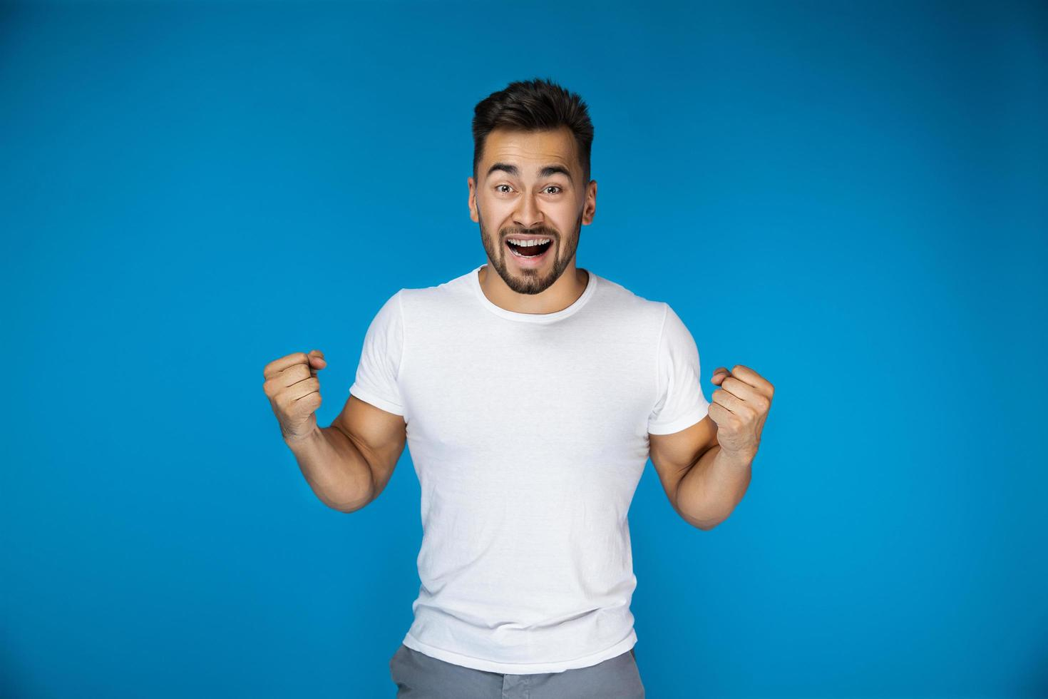 Excited man in white shirt photo
