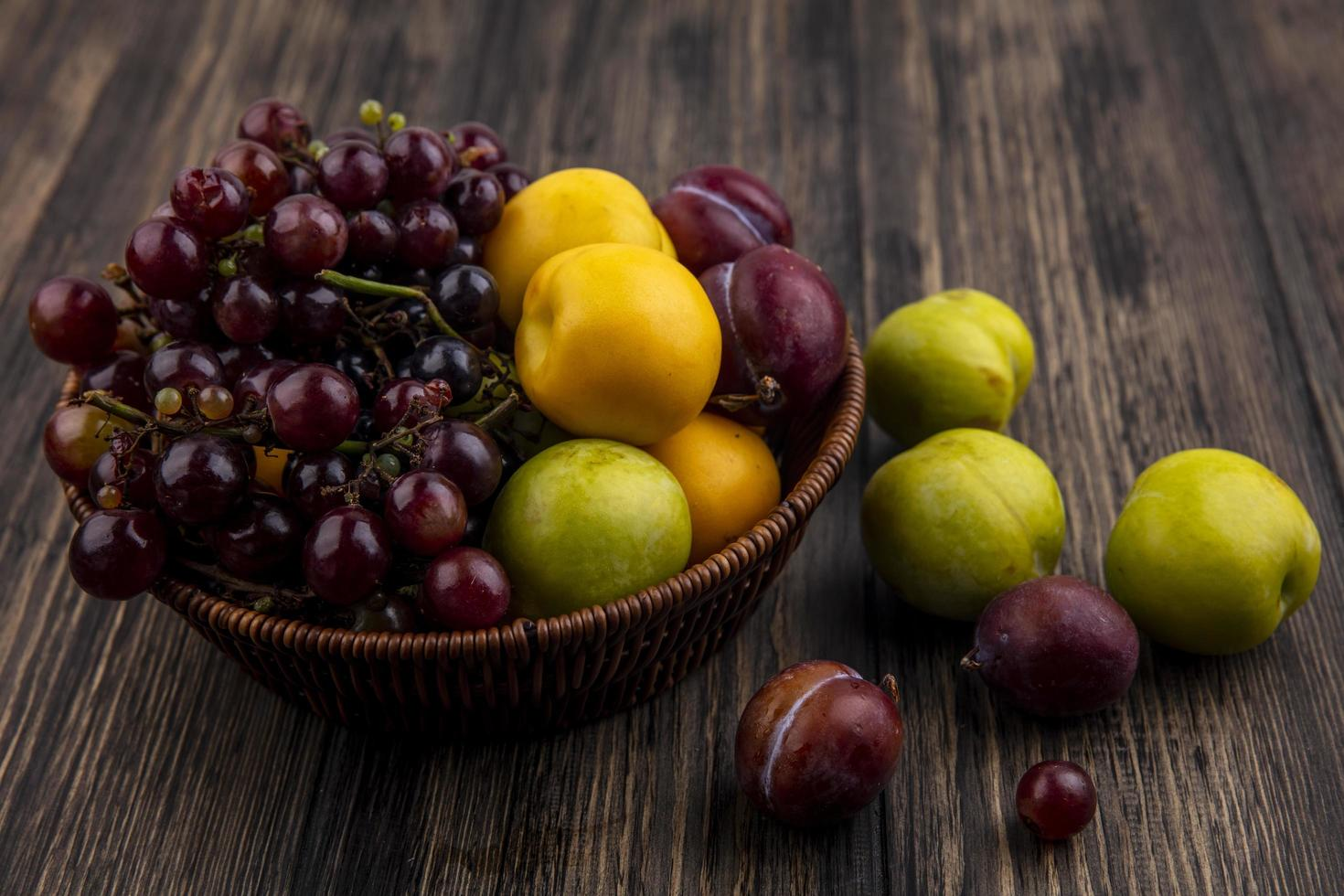 Assorted fruit on wooden background photo
