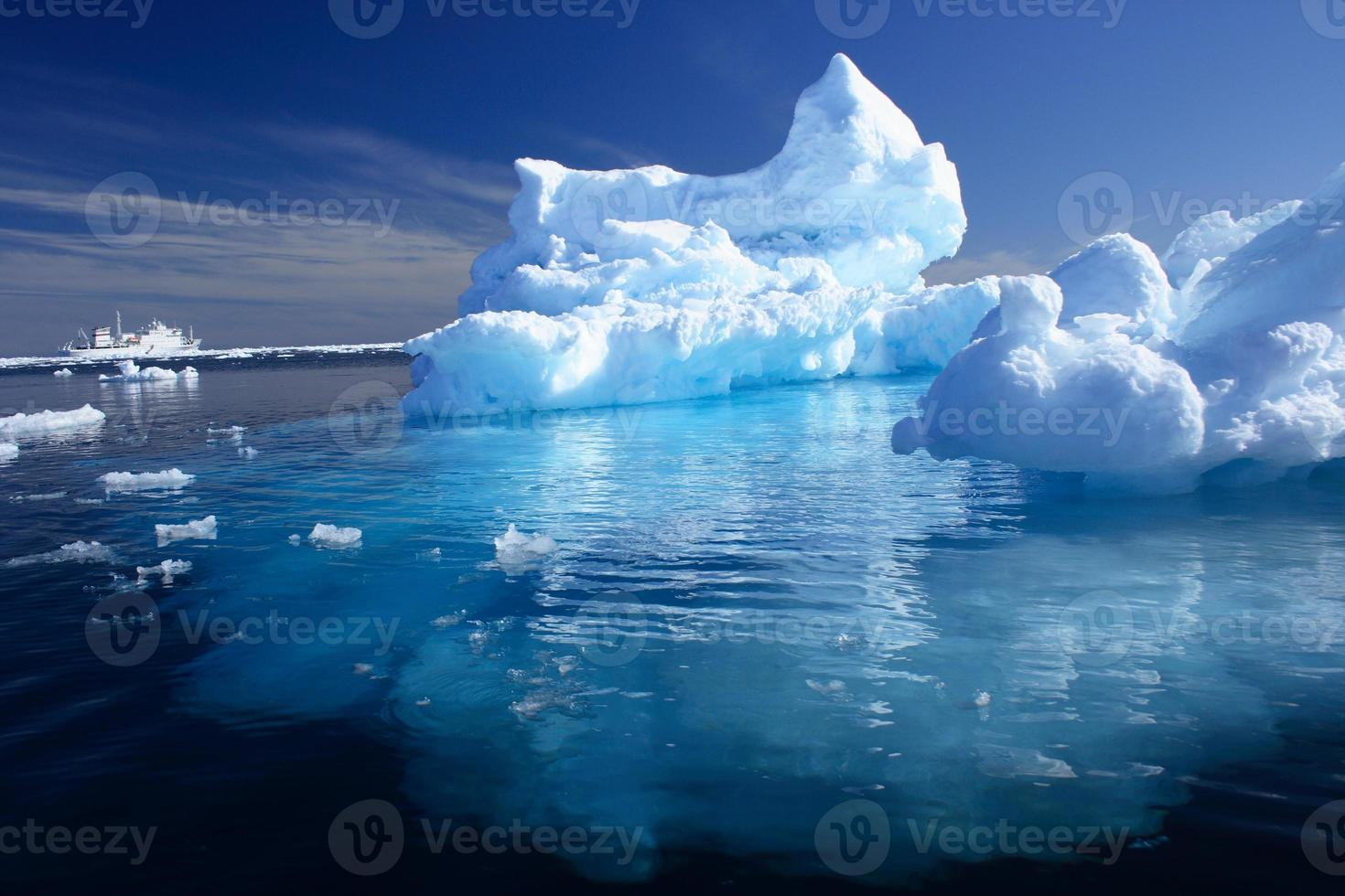 Iceberg and Ship in the Arctic photo