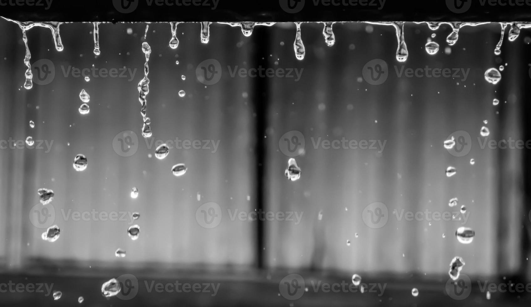 Circular rain drops from shelter in rainy season, Thailand photo