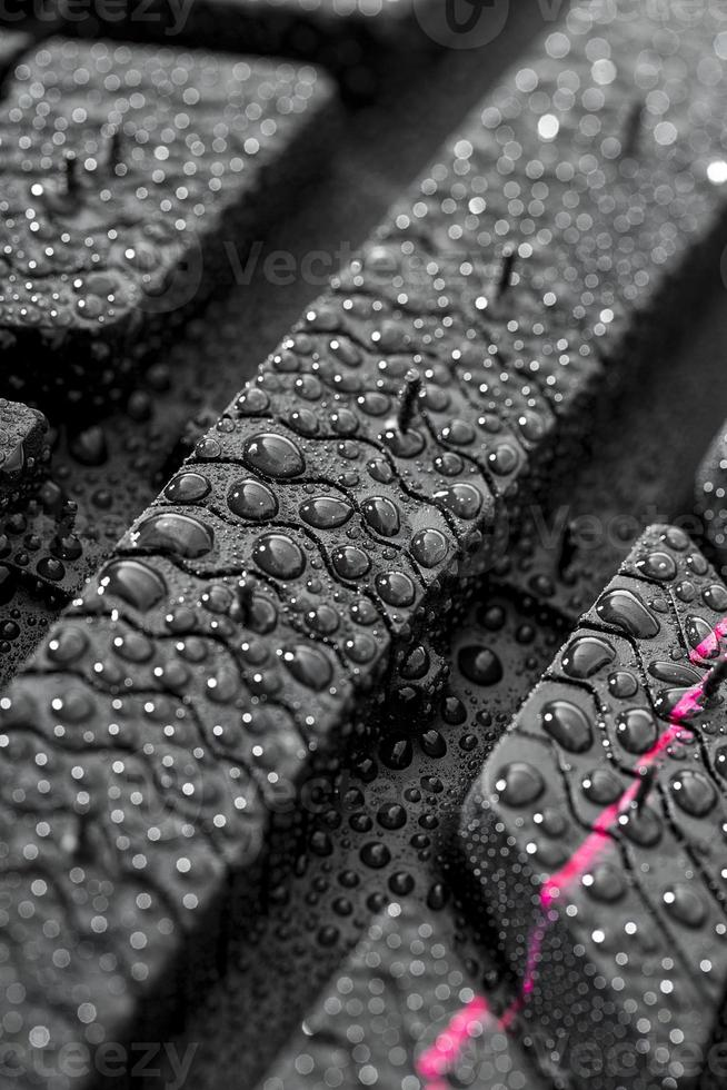 Car tire close-up with waterdrops photo