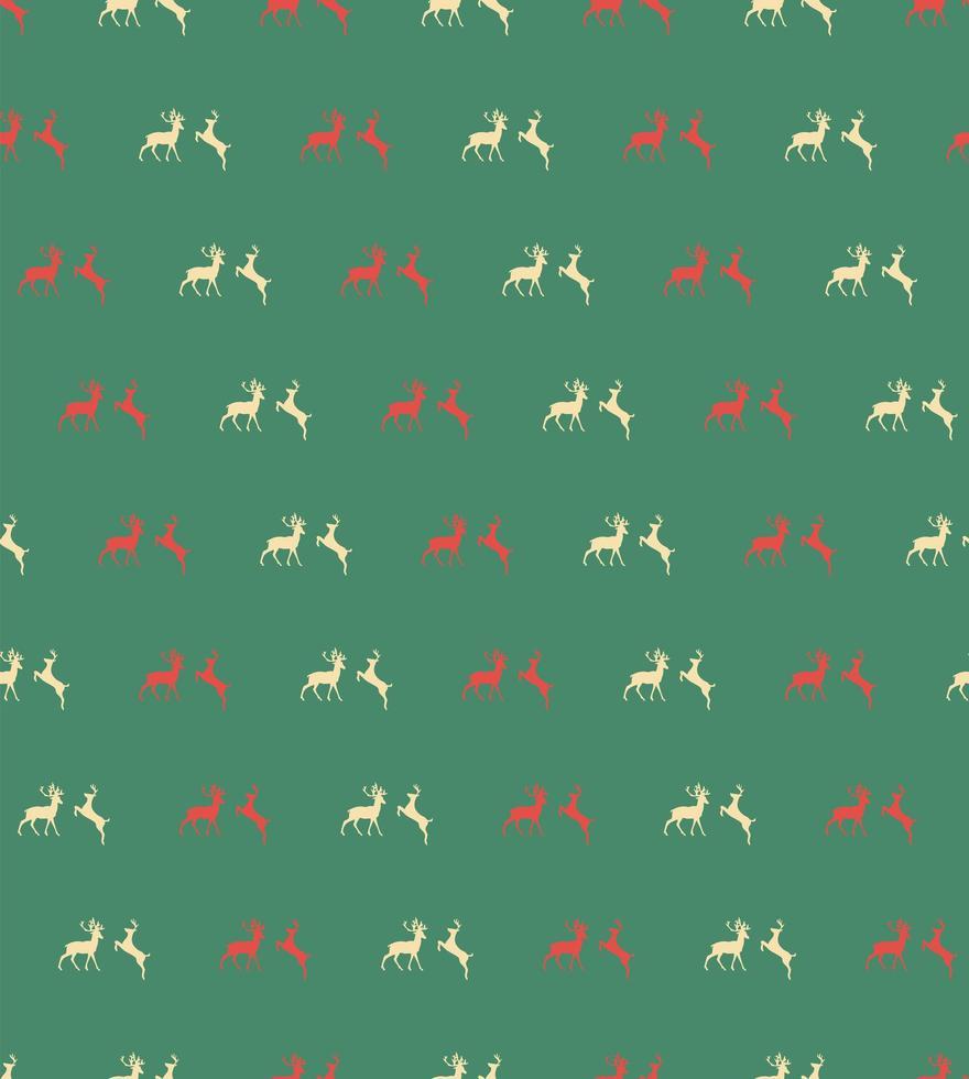 patrón sin fisuras con renos de Navidad sobre fondo verde vector