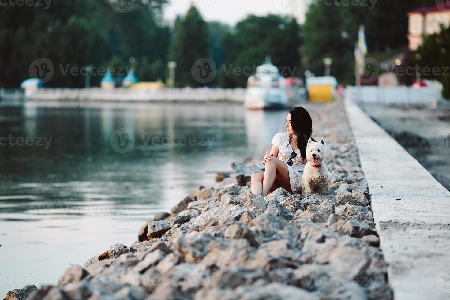 girl with a dog on the promenade photo