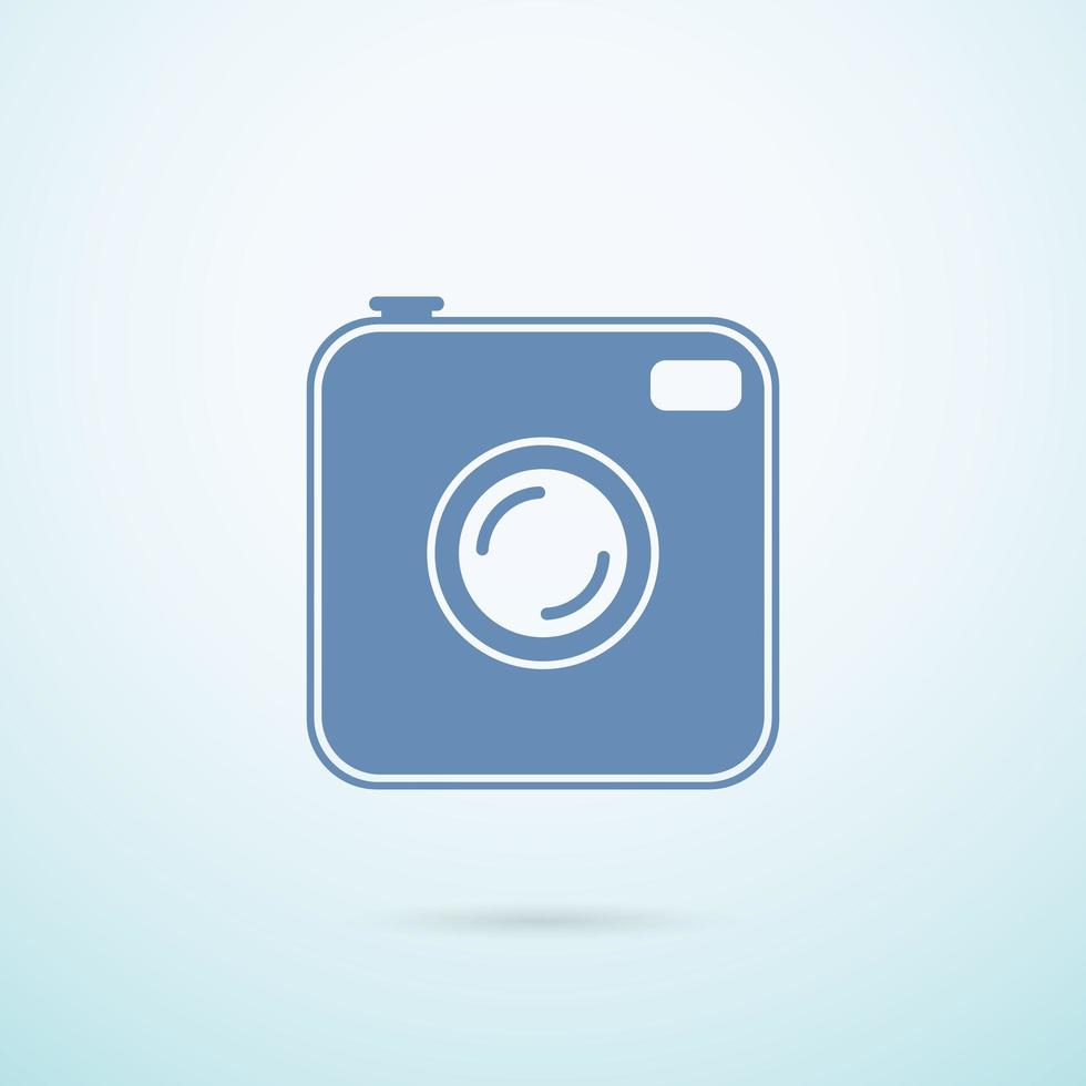 Old photocamera flat icon on blue background vector