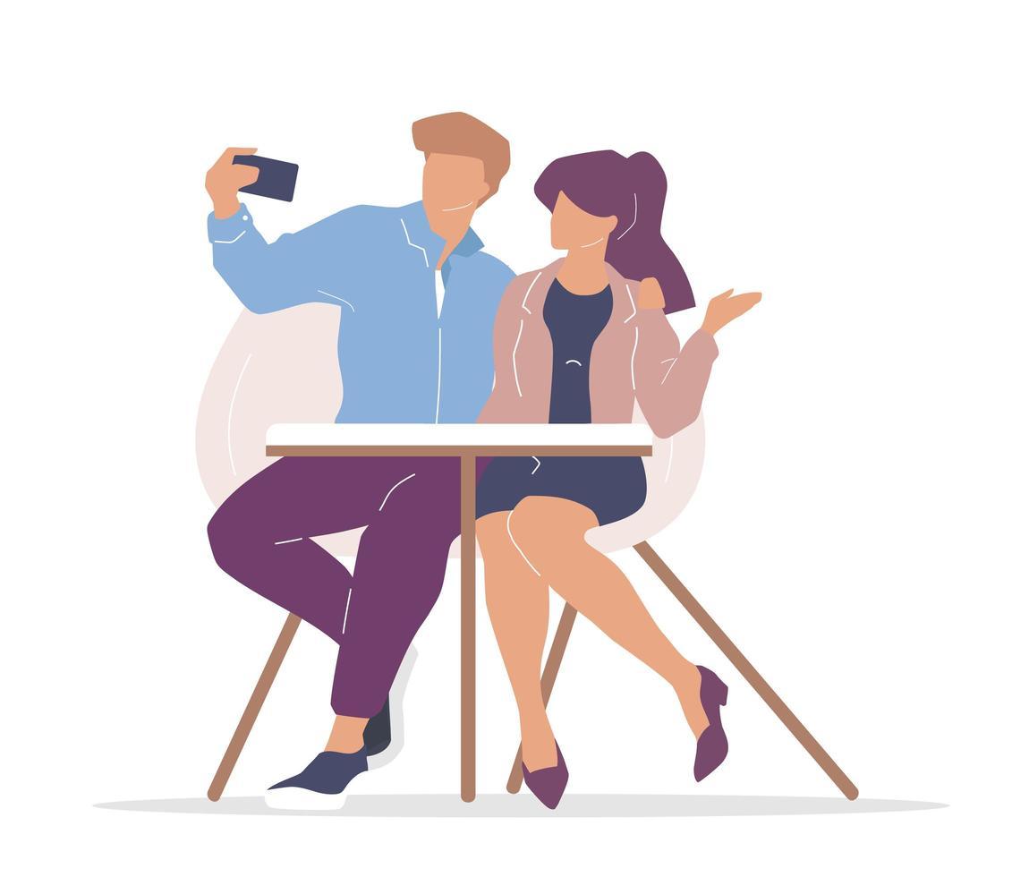 pareja en cafe tomando un selfie vector