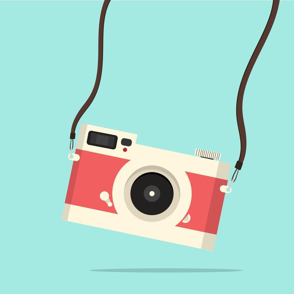 cámara vintage roja colgando estilo plano vector