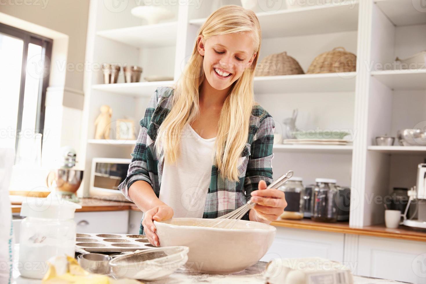Young girl baking at home photo