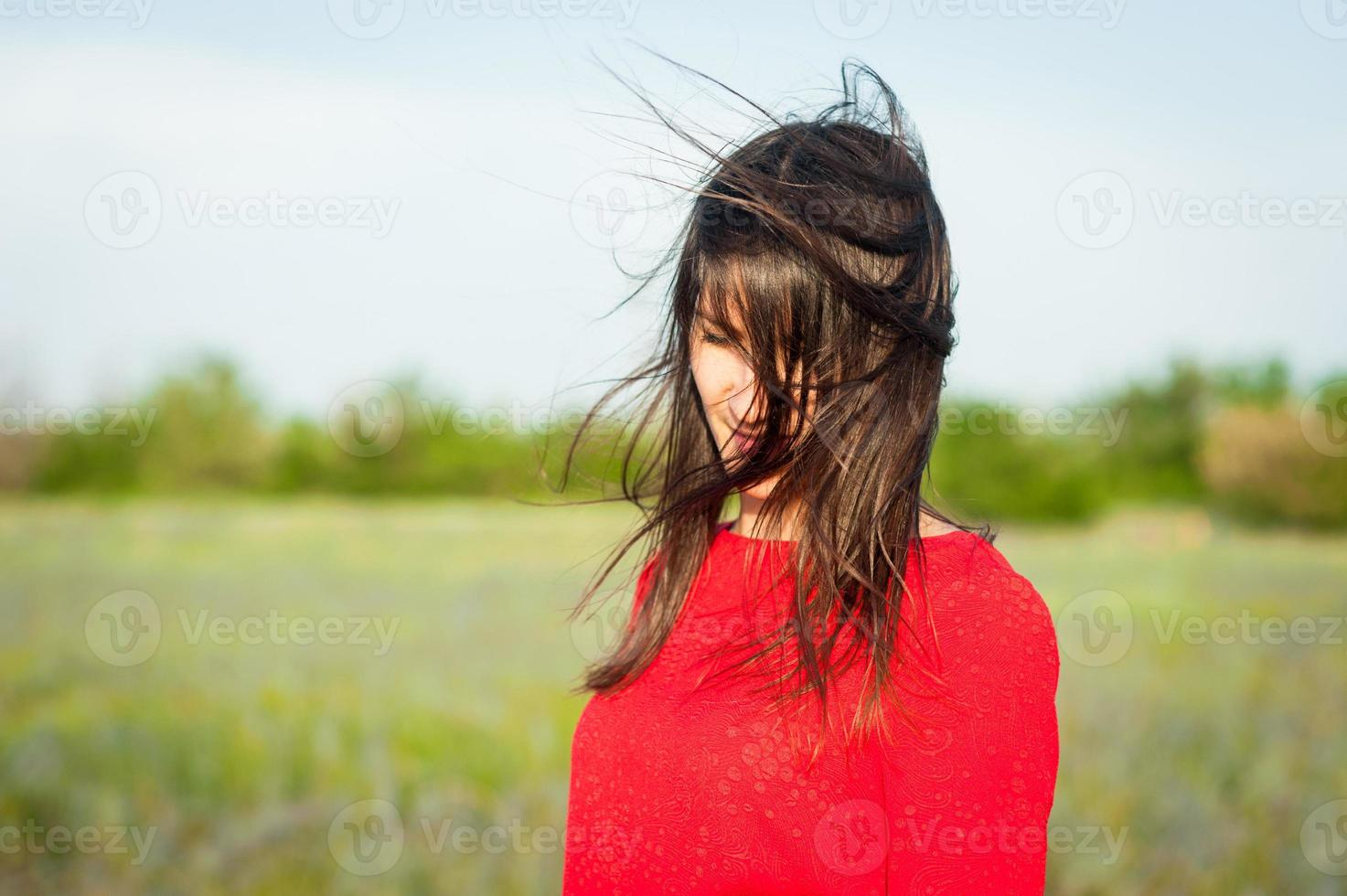 Shy woman with fluttering hair. photo