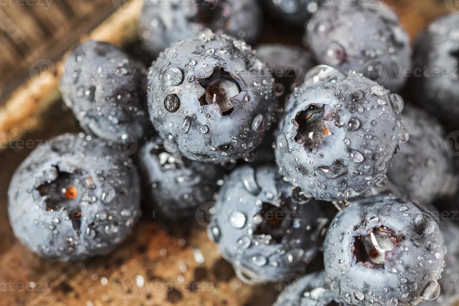 Wet fresh Blueberry on wooden background photo