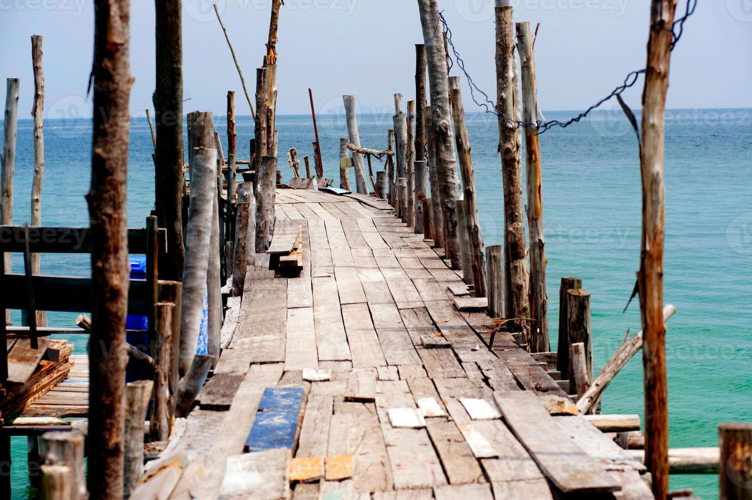 Traditional wooden bridge on the beach. photo