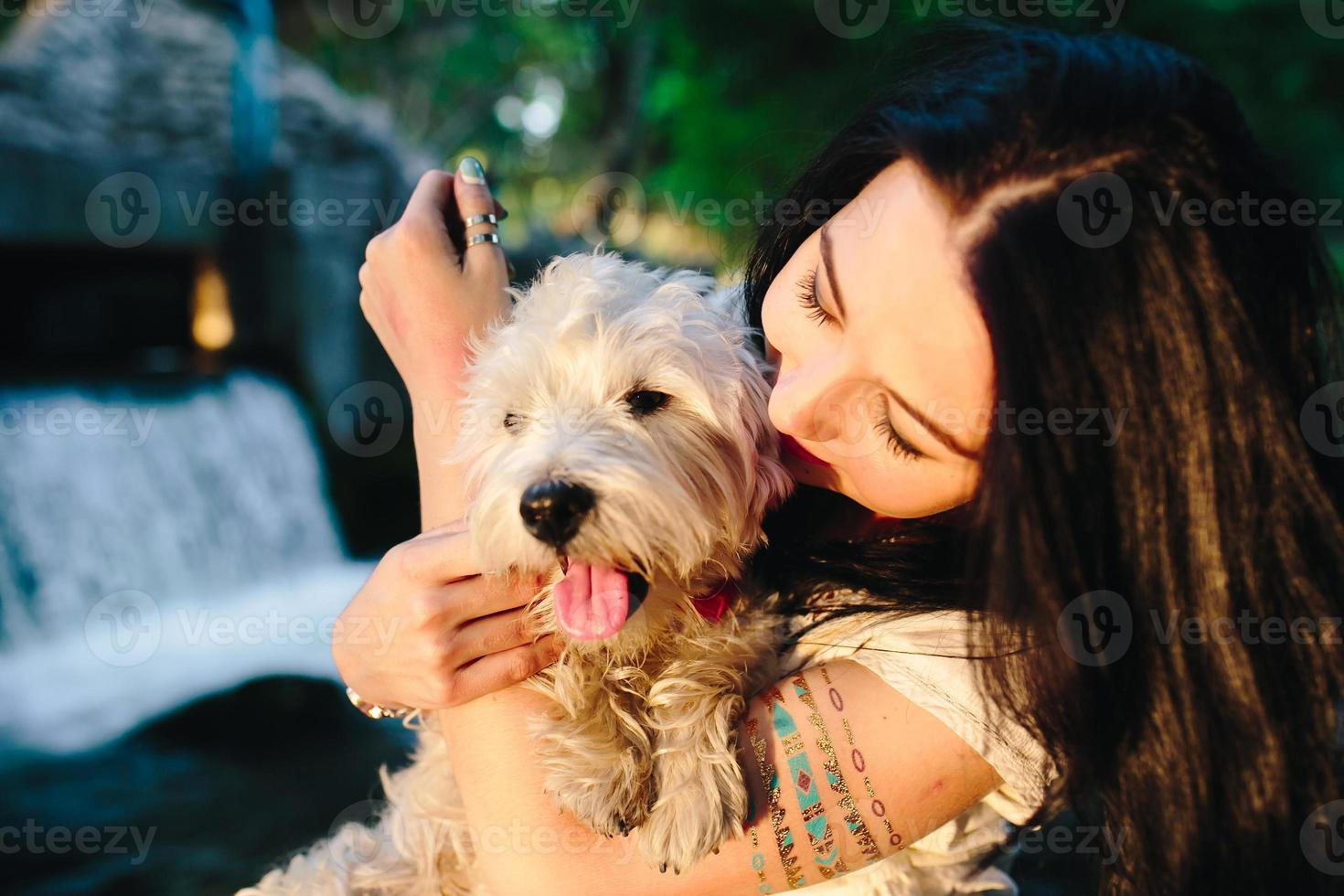 girl playing with a dog photo