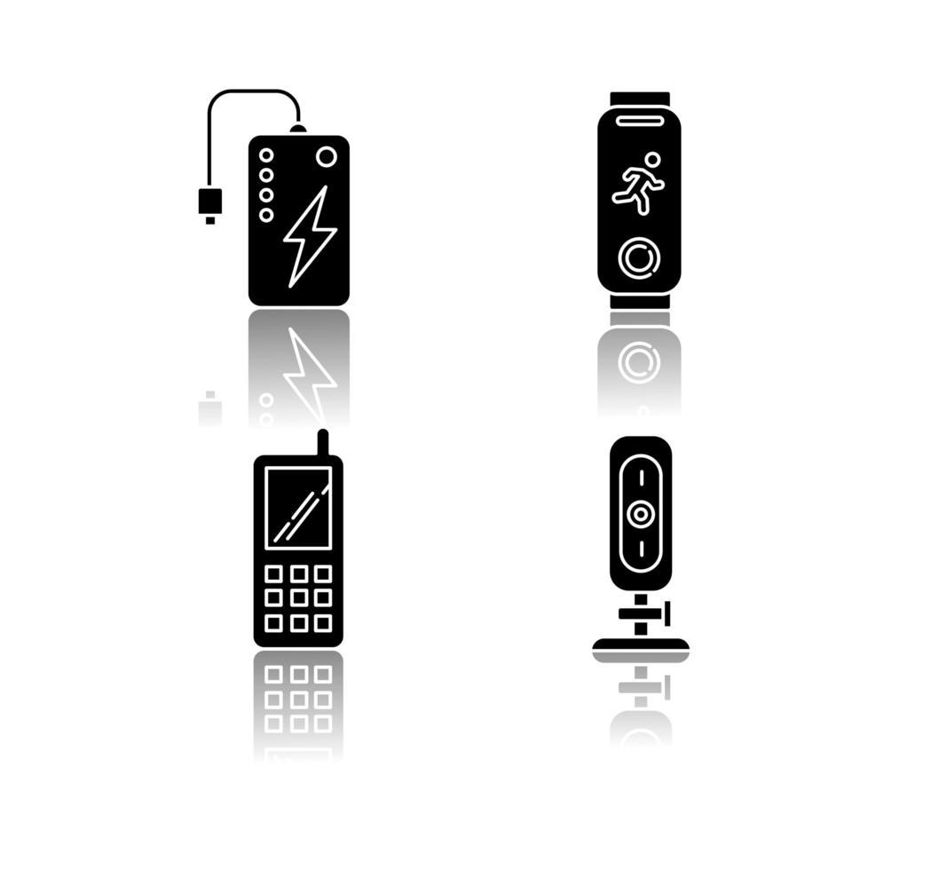 Los dispositivos móviles dejan caer los iconos de glifos negros de sombra. vector