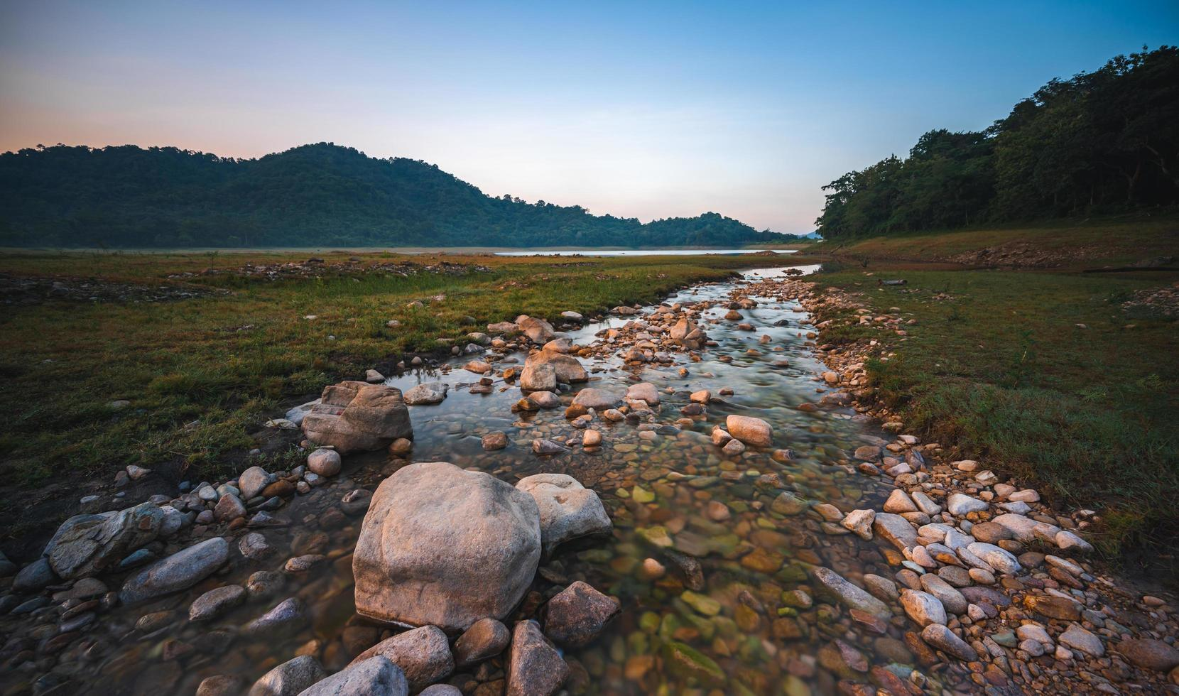 Nature landscape view of fresh water stream photo