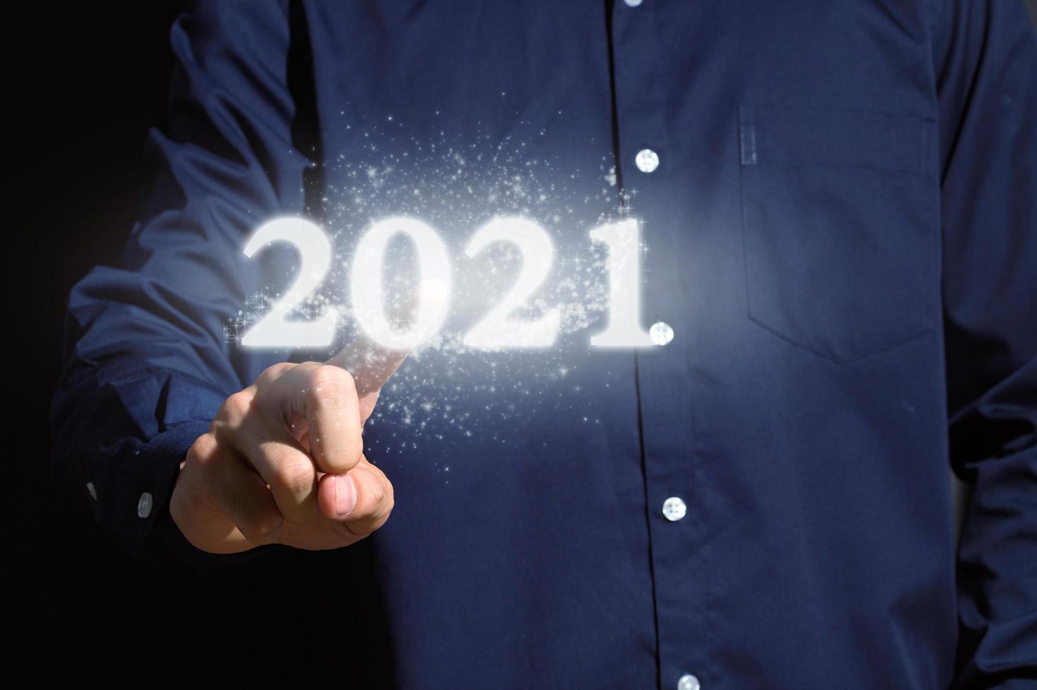Human hand and 2021 inscription photo