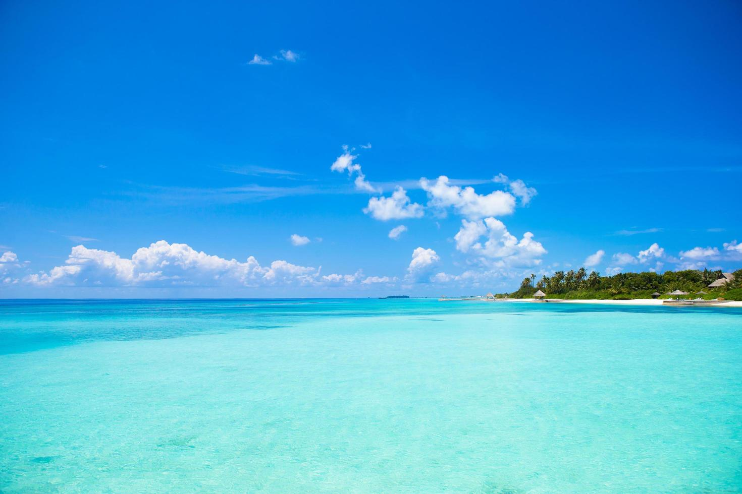 Turquoise water at a tropical beach photo