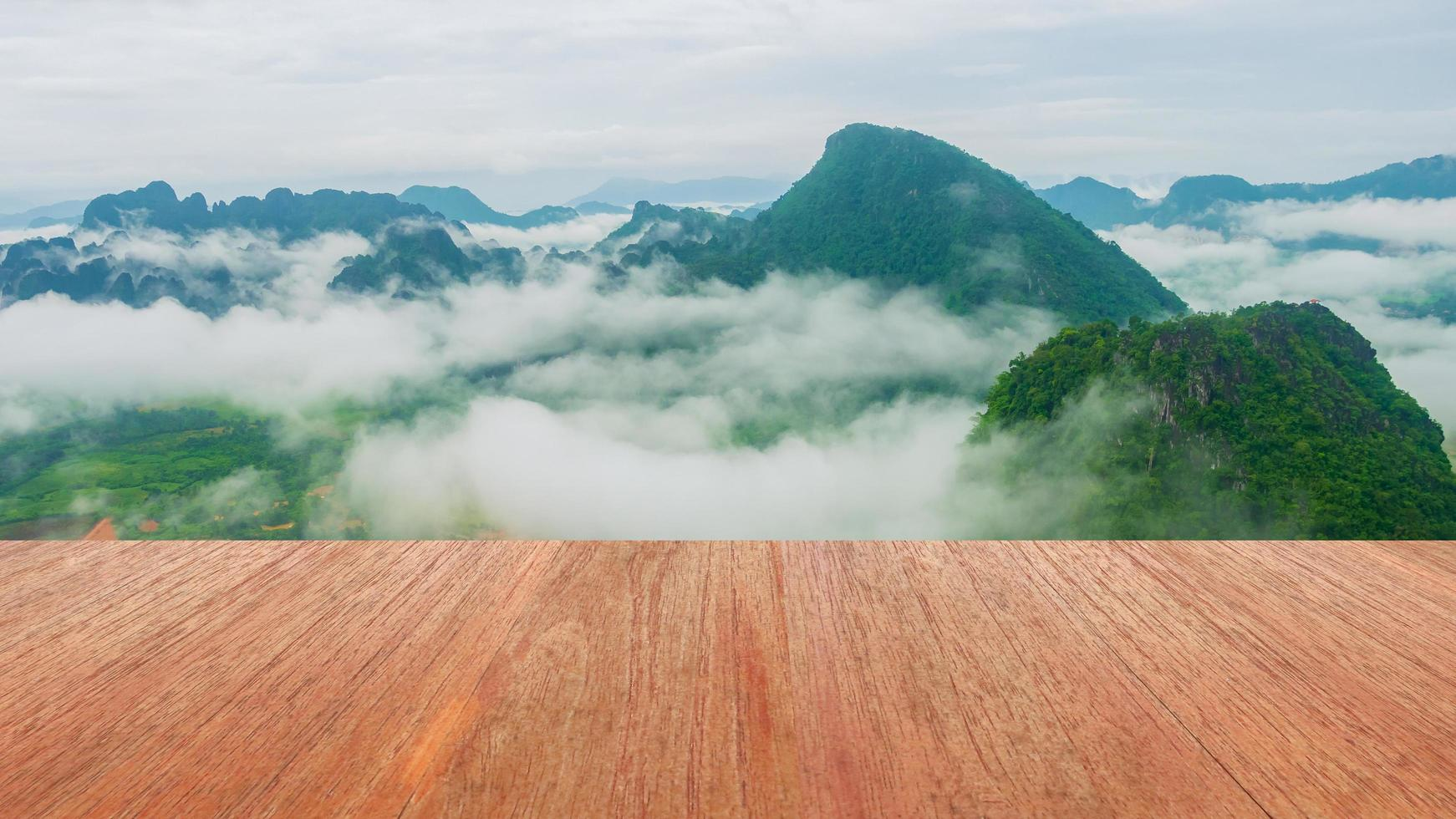 Natural wood floor, mountain view and morning mist photo