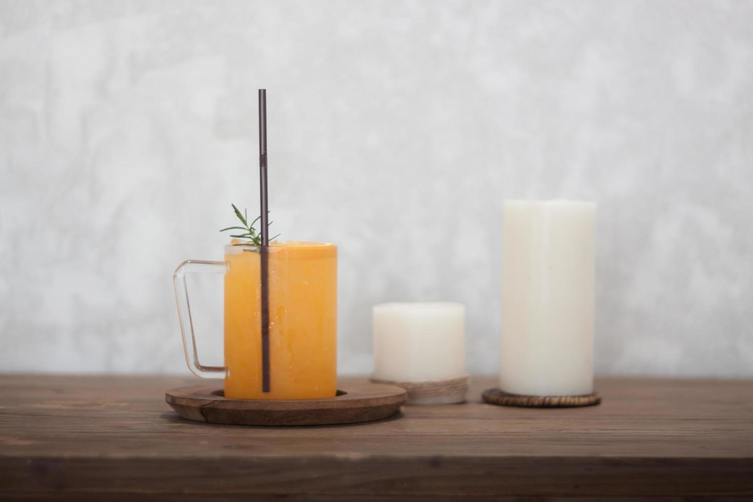 Orange juice and candles photo