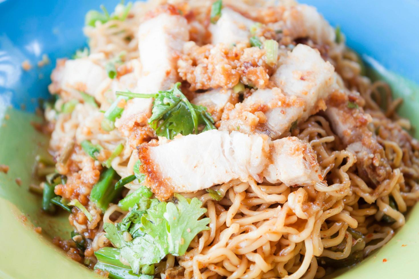 Pork stir fry spicy noodle dish photo