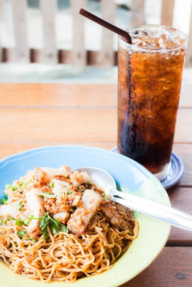 Stir fried spicy noodles and a cola photo