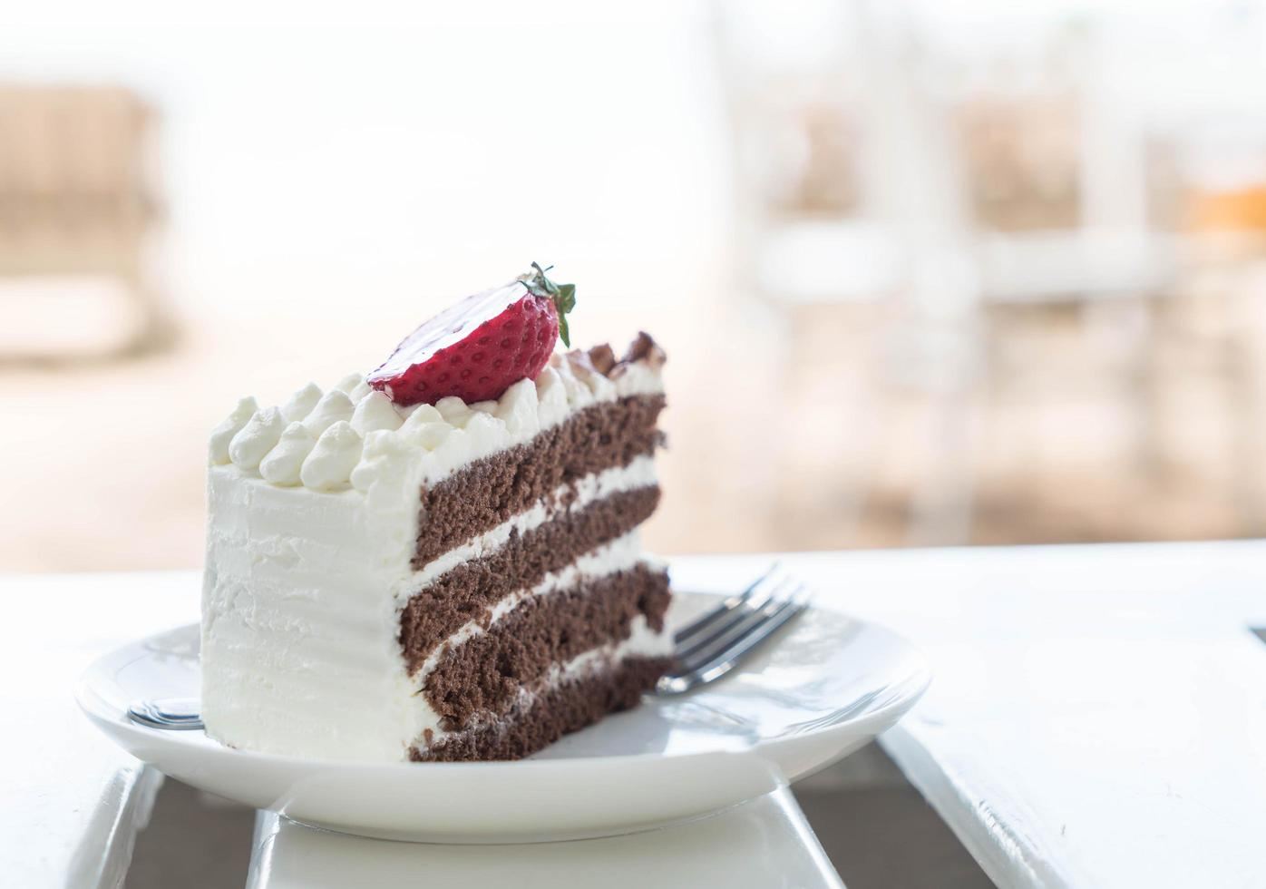 Vanilla and chocolate cake with strawberry photo