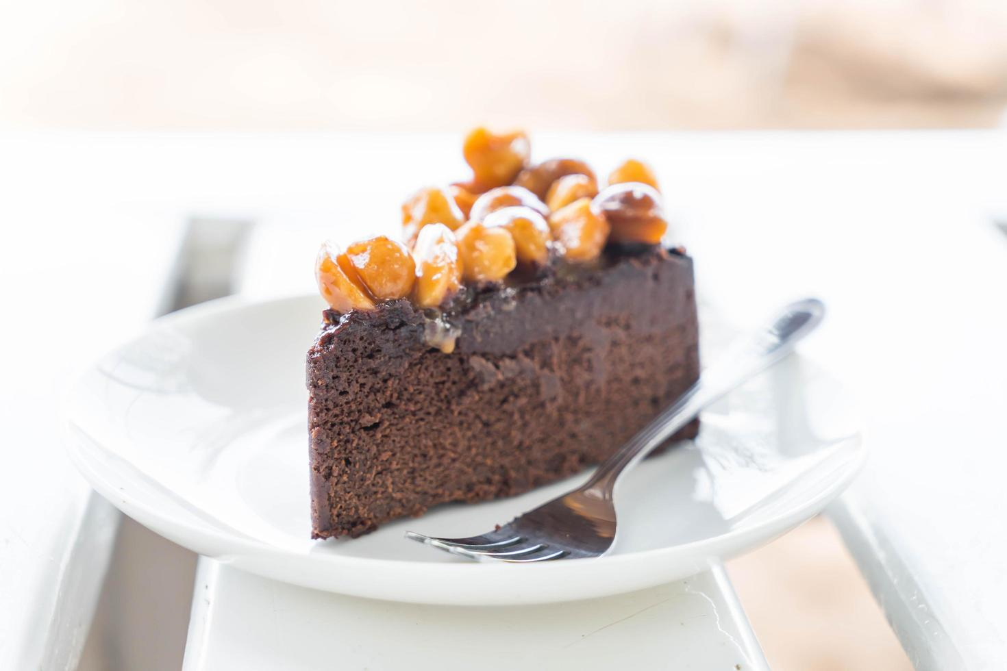 Macadamia chocolate cake on minimal white background photo