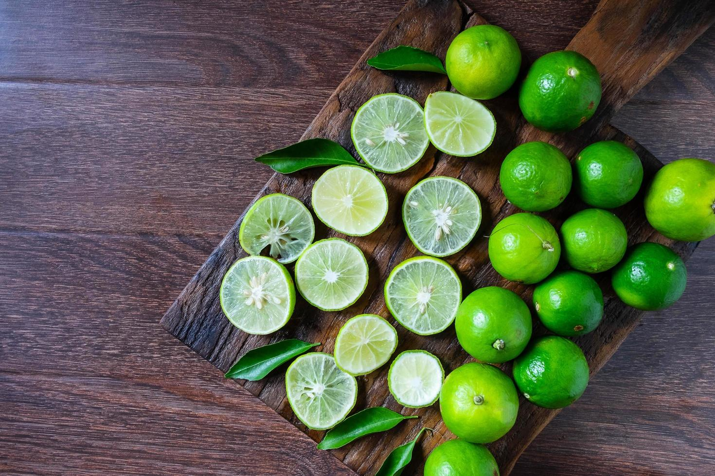 Limes on the cutting board photo