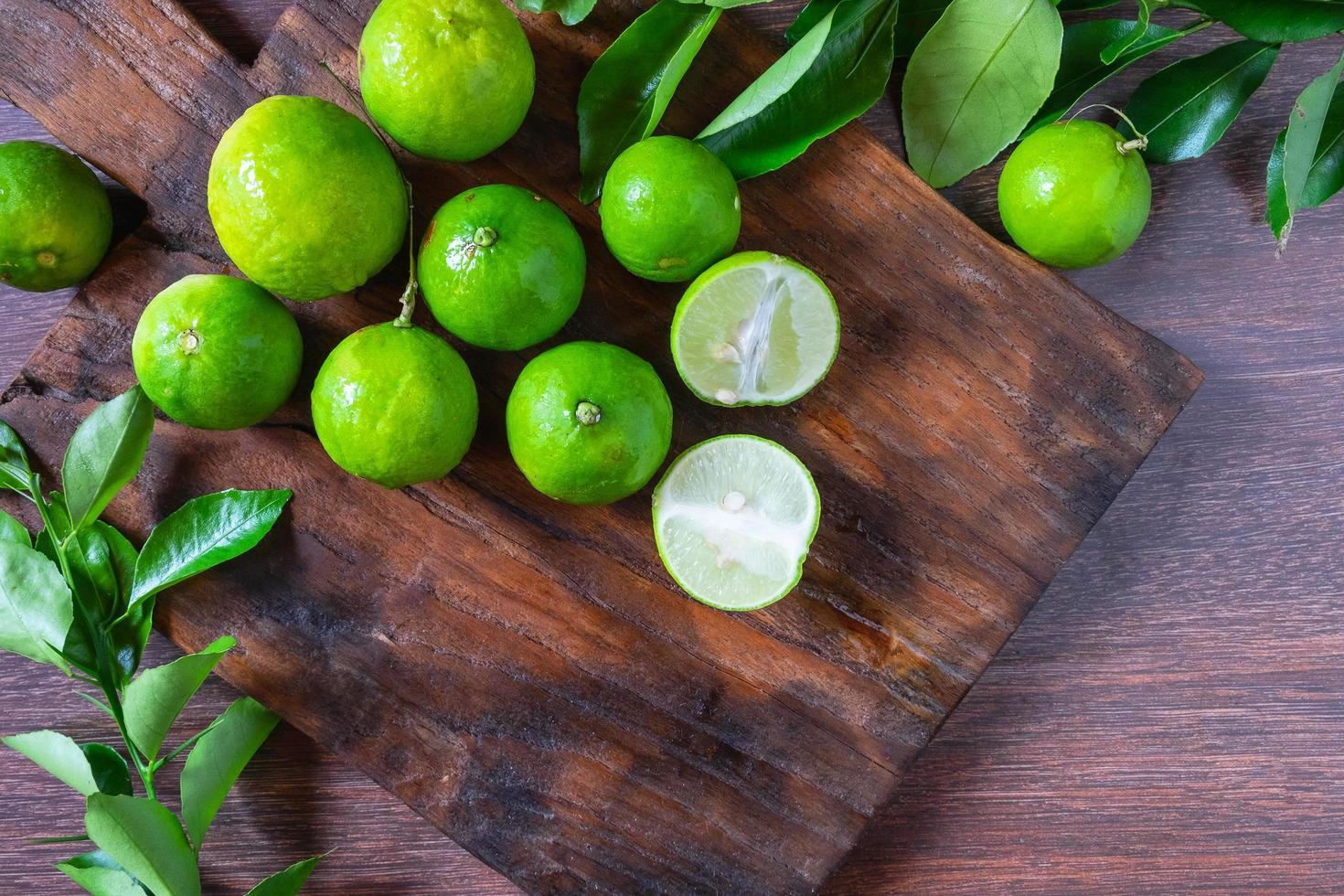Limes on a cutting board photo