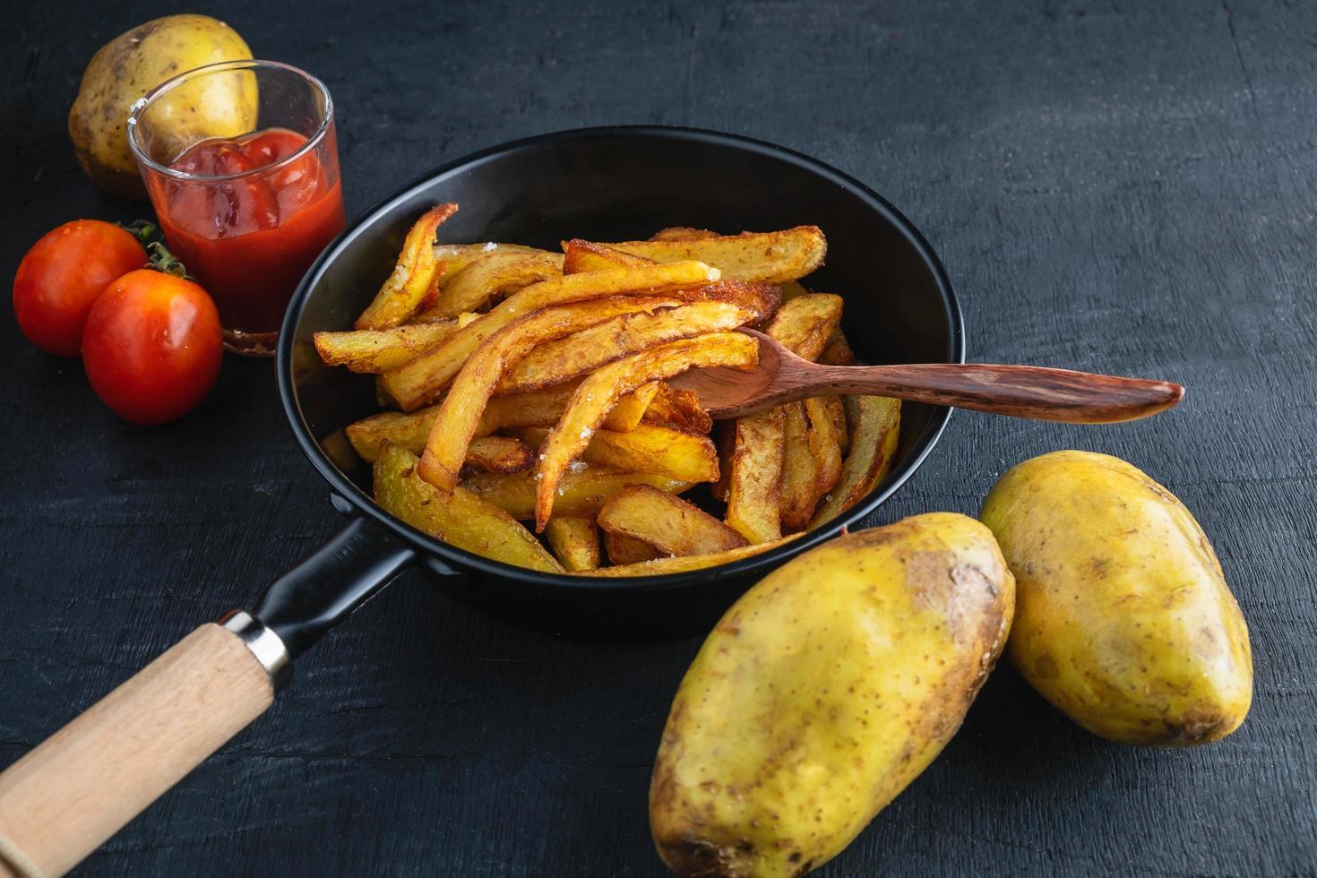 Cook fried potatoes photo