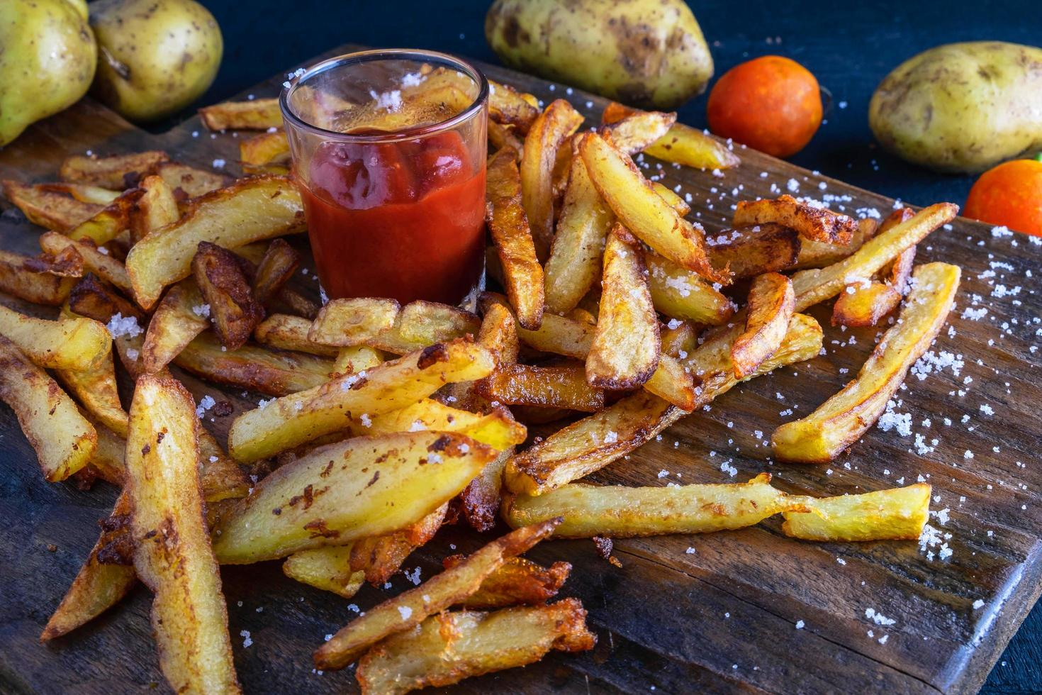 Homemade baked potato fries with ketchup photo