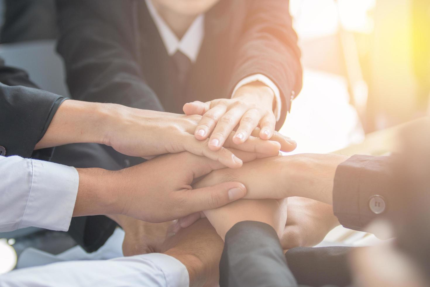 Concept of teamwork, business people join hands photo