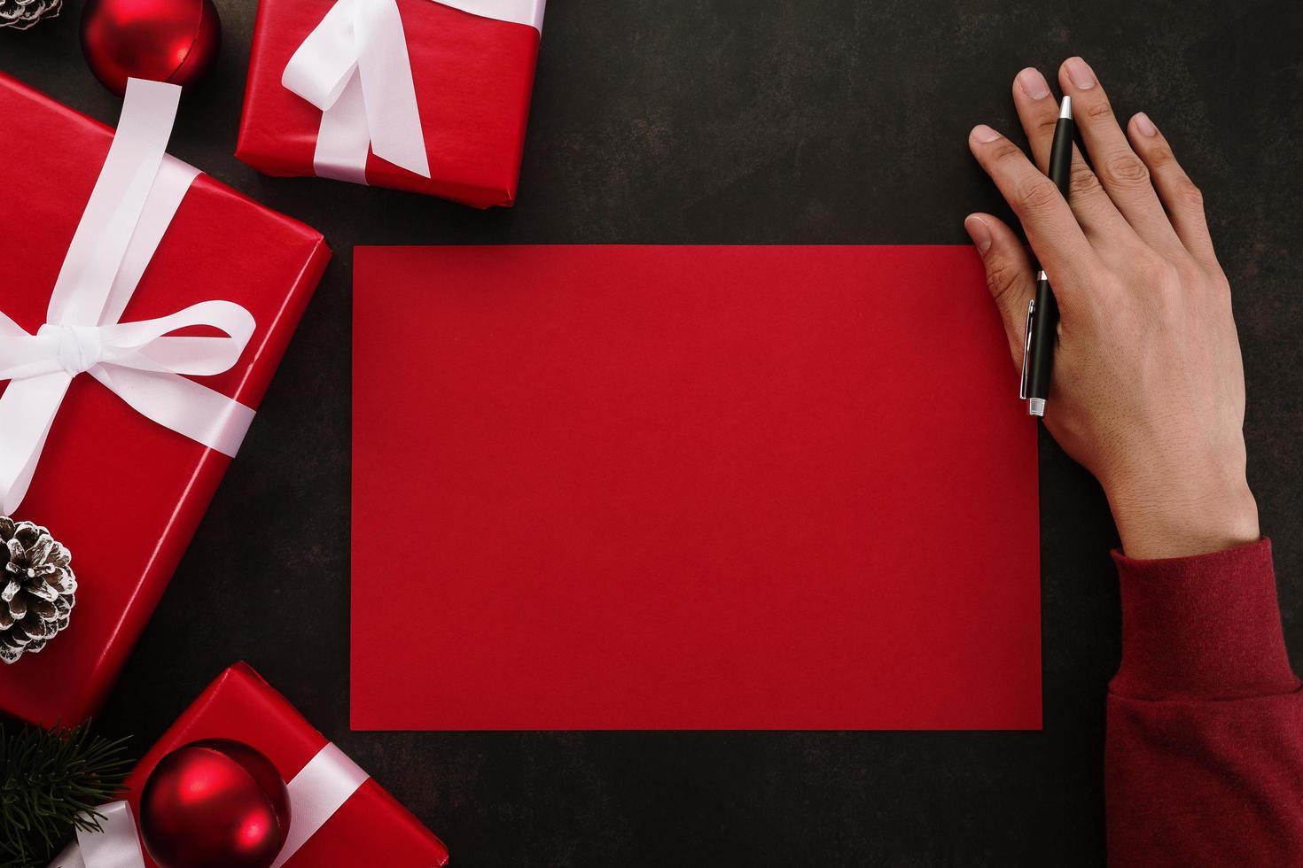 Hands writing red greeting card mockup photo