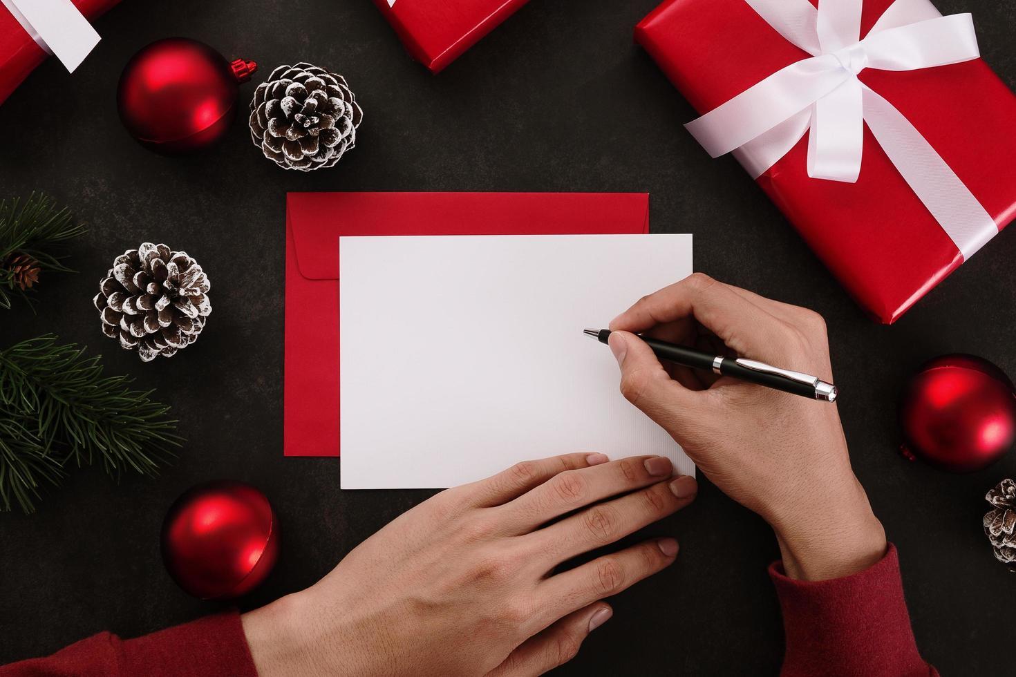 Hands writing white greeting card mockup photo