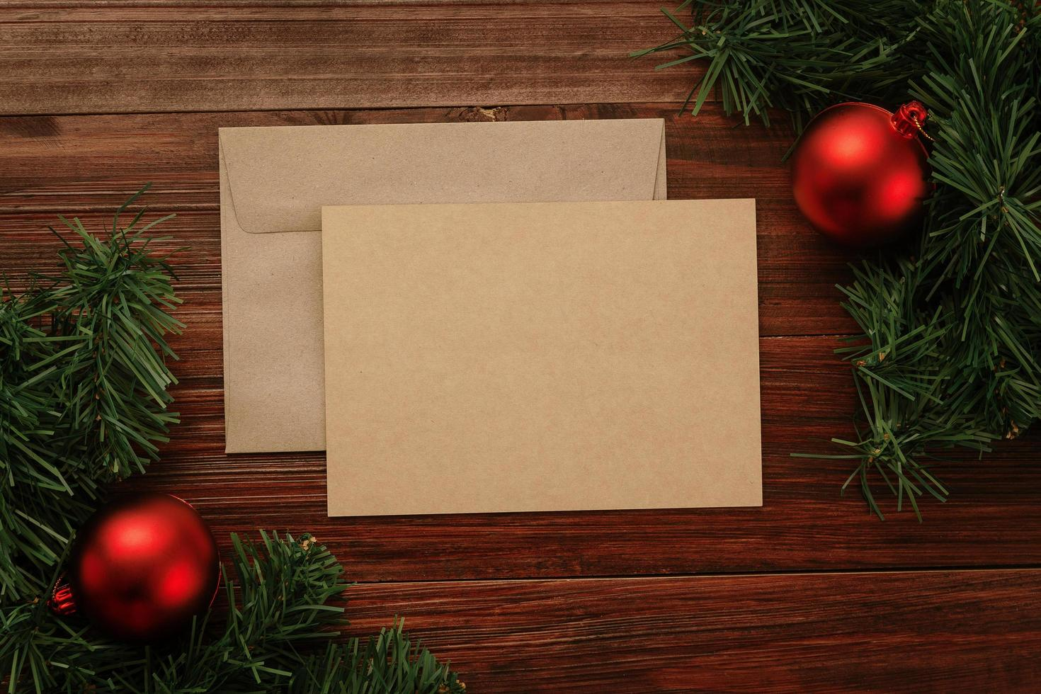 Merry Christmas greeting card and envelope mockup photo