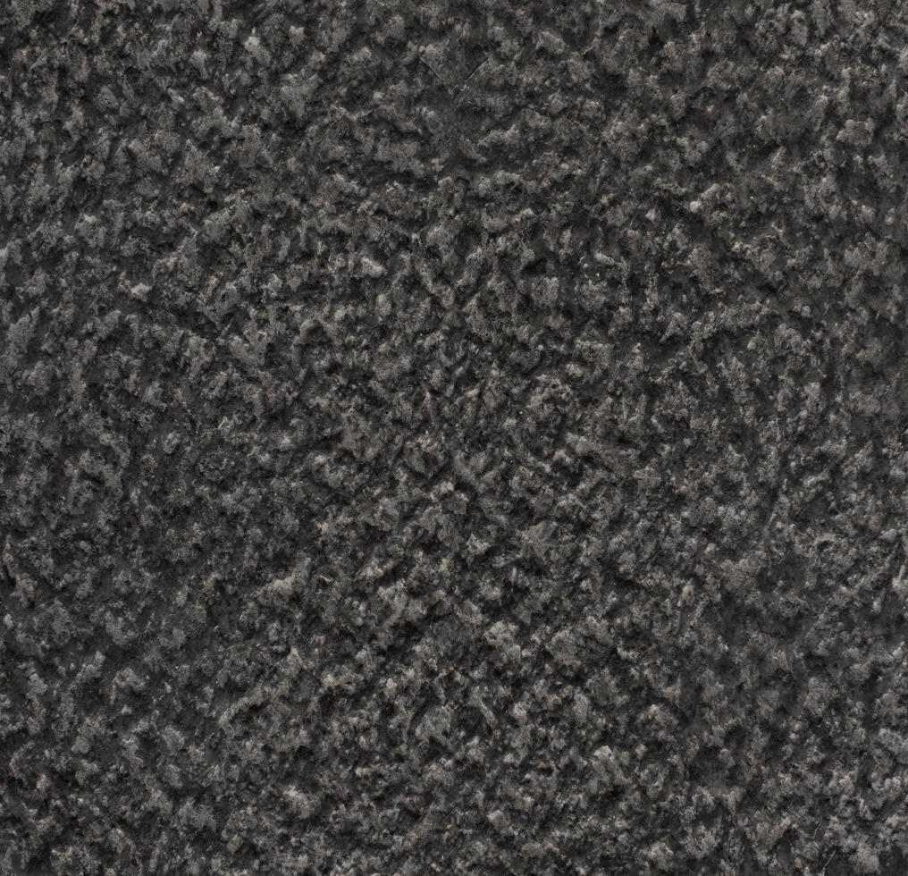 textura de muro de hormigón negro foto