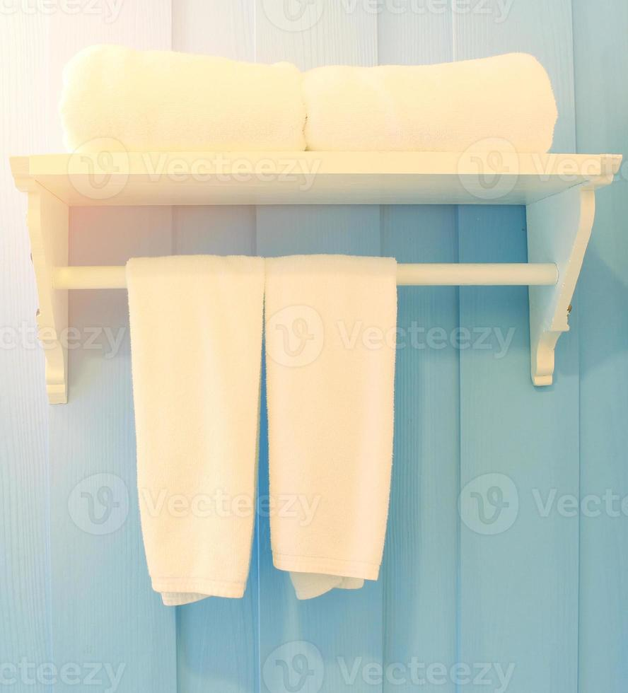 Clean white towels on a hanger photo